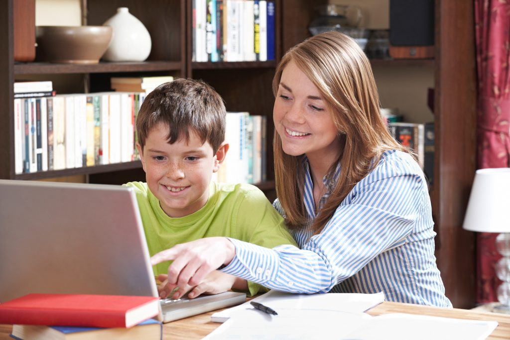 Primary Tutor and student learning at home one-to-one tuition